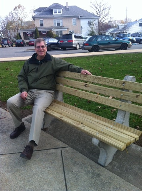 Mr. Schmitz takes a break from counseling to enjoy the park bench we made for Lewisburg Area School District.