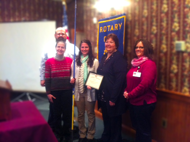 Ginny Johnson, parents Tim and Crystal, Rotarian Marcia Cooney, and instructor Pat Millett