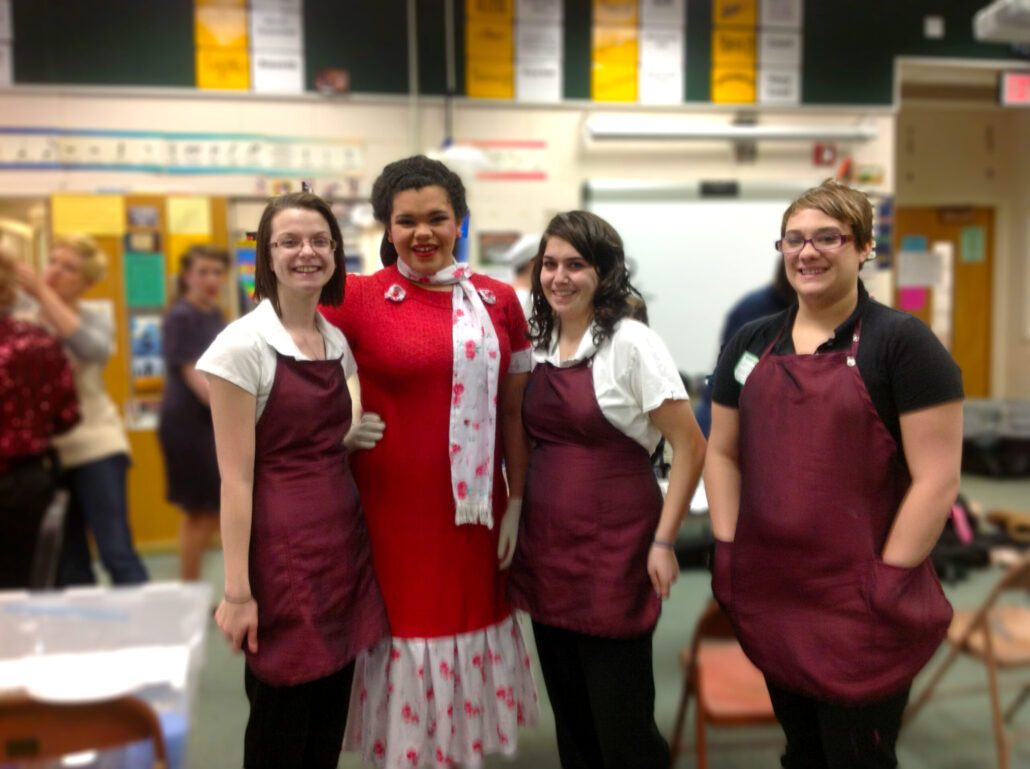 Cosmetology students Samantha Robinson, Andria Hughes, ( Lewisburg ensemble student Tenaja Henson) and cosmetology student Odessa Longer