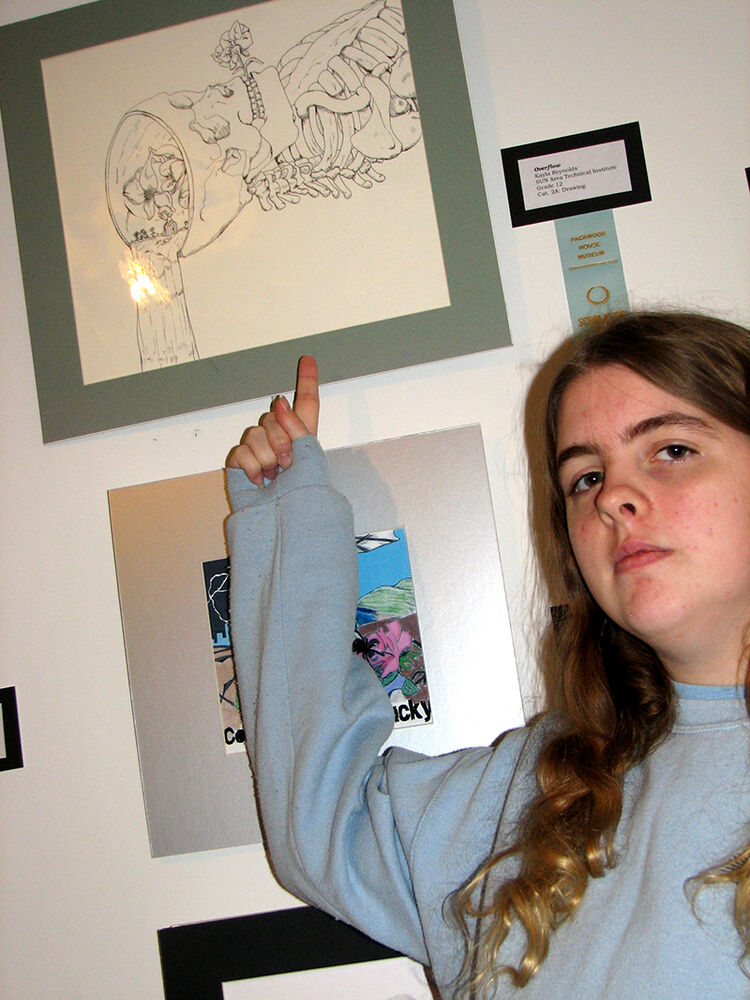 """Kayla Reynolds, an Advertising Art & Design student at SUN Area Technical Institute, received an honorable mention award at the Packwood House Museum's 35th annual Scholastic Arts Exhibit for an ink drawing titled """"Overflow."""""""